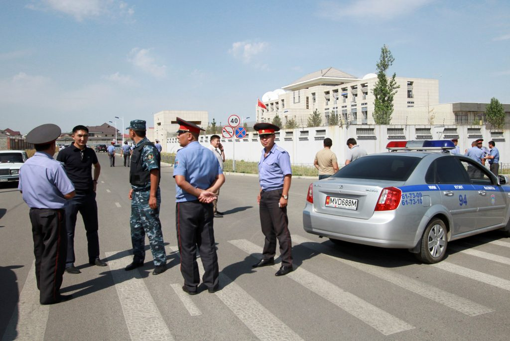 Investigators, Interior Ministry officers and members of security forces gather near the site of a bomb blast outside China's embassy in Bishkek, Kyrgyzstan, August 30, 2016. REUTERS/Vladimir Pirogov TPX IMAGES OF THE DAY