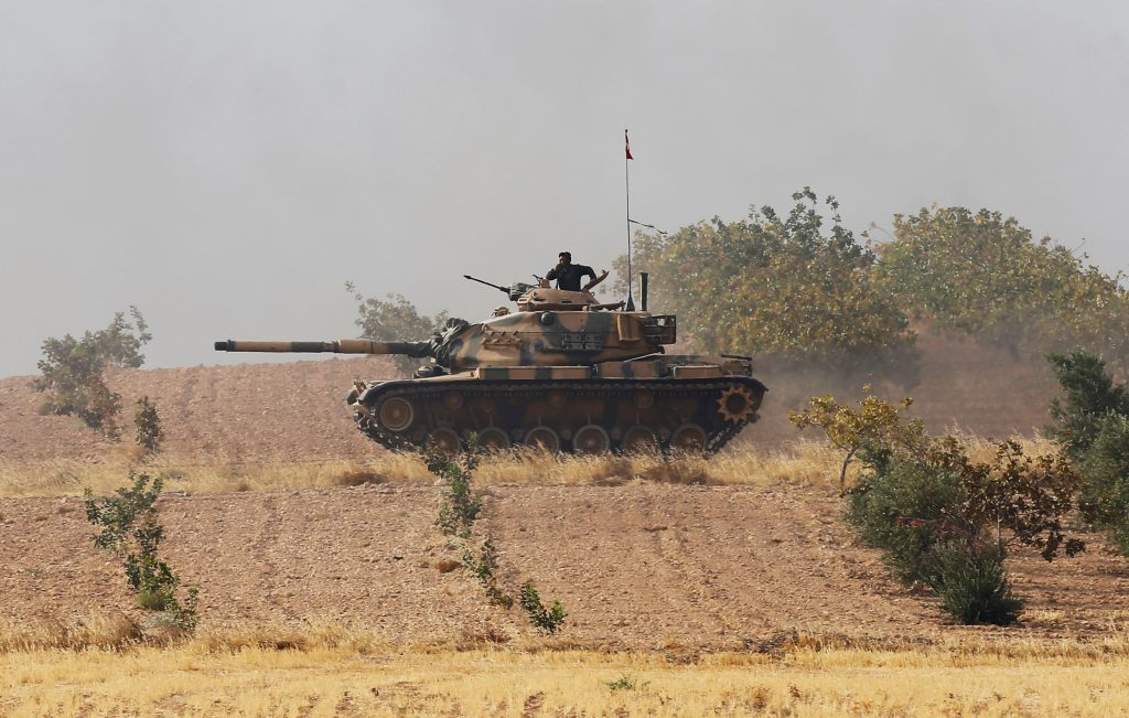 A Turkish army tank drives towards to the border in Karkamis on the Turkish-Syrian border in the southeastern Gaziantep province, Turkey, August 25, 2016. REUTERS/Umit Bektas