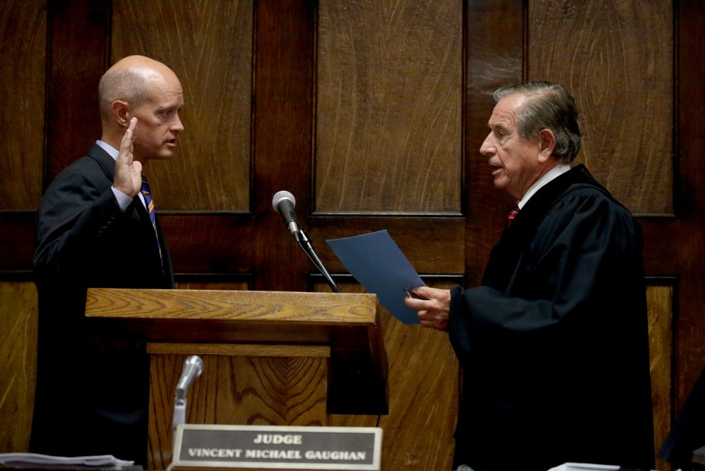 Kane County State's Attorney Joseph McMahon is sworn in Thursday by Judge Vincent Gaughan as the independent attorney to prosecute a Chicago police officer. (Nancy Stone/Chicago Tribune, Pool)