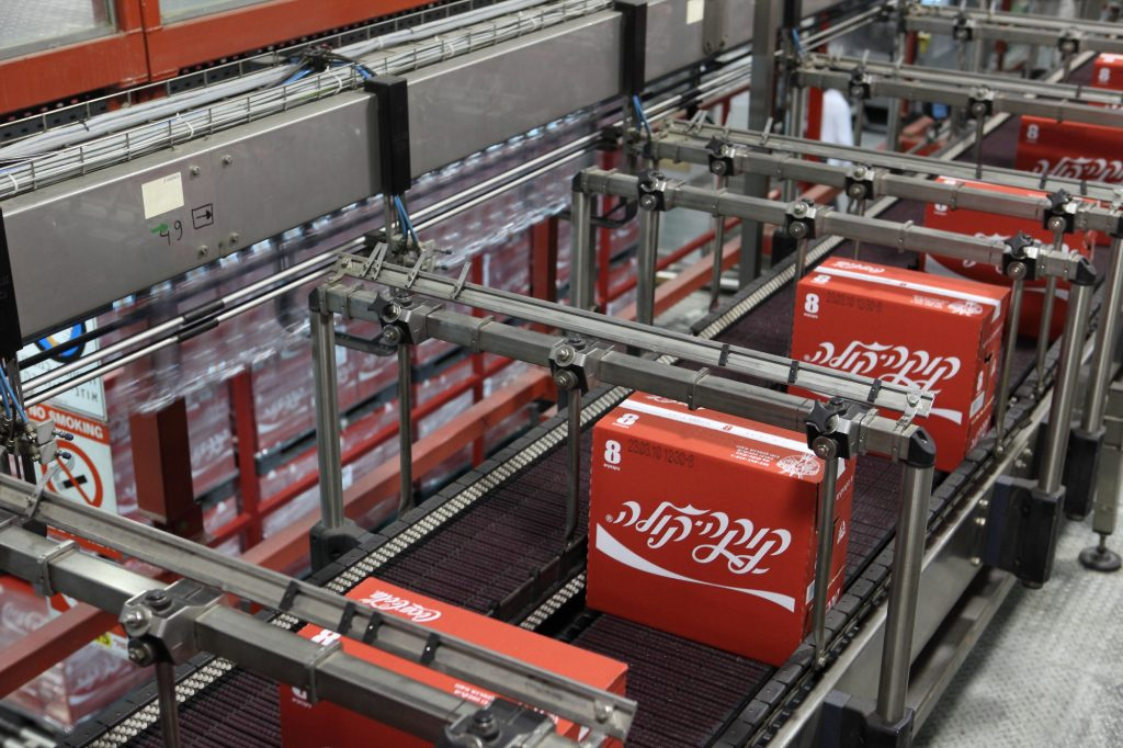 Boxes of Coca-Cola bottles with Hebrew lettering on the assembly line at the Coca Cola plant in Bnei Brak. (Yaakov Naumi/Flash90)