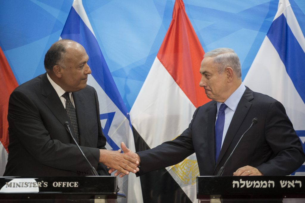 Egypt's Foreign Minister Sameh Shoukry shaking hands with Prime Minister Binyamin Netanyahu in Yerushalayim, on July 10. (Hadas Parush/Flash90)