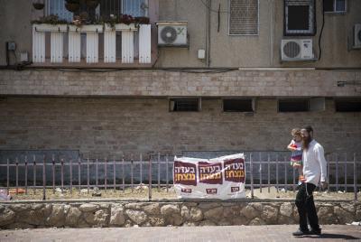 A man walks down a Kiryat Malachi street. Photo by Hadas Parush/Flash90