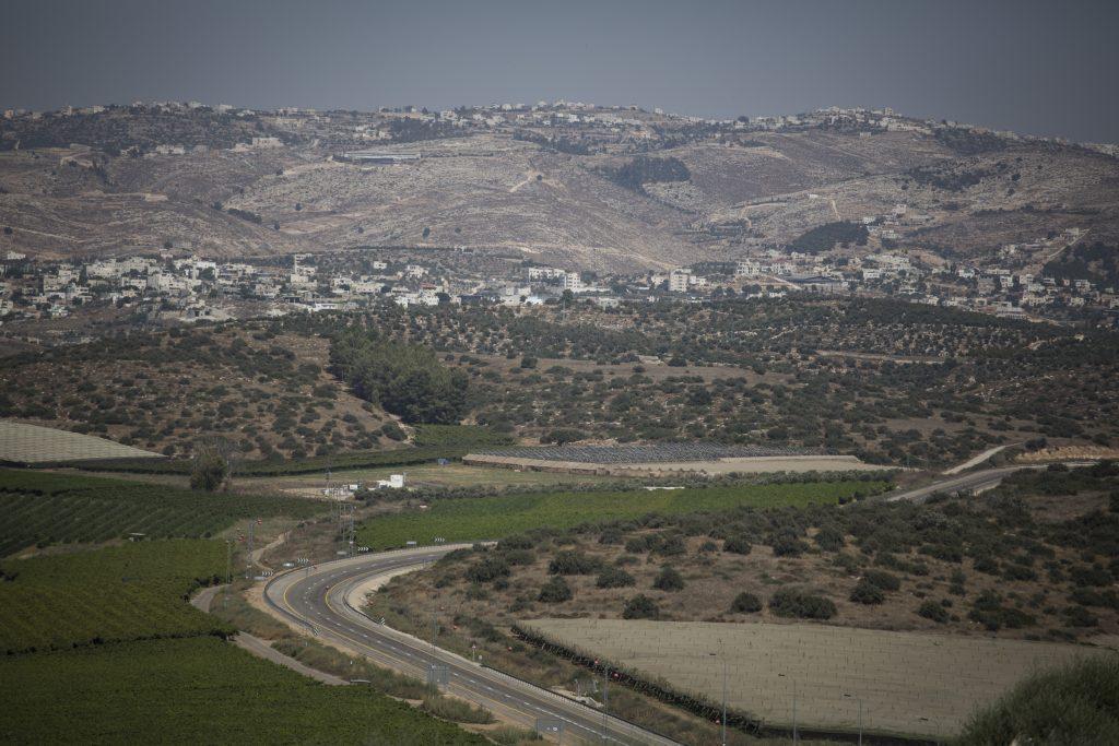 The South Mount Hebron area, seen from the hills where the town of Karmei Katif will be built. Karmei Katif has been in the process of approval for building for Gush Katif evacuees, who have been on hold in temporary housing units for the past 10 years since being evacuated from the Gaza settlement of Katif. This year marks 10 years since the forced evacuation from the Gaza Jewish settlements of Gush Katif. July 20, 2015. Photo by Hadas Parush/Flash90 *** Local Caption *** ééùåá éäåãé ãøåí éùøàì âåù ÷èéó 10 ùðéí éåí æéëøåï øçåá áúéí îôåðé âåù ÷èéó àîöéä ëøîé ÷èéó ÷øååàï ÷øååàðéí îâøùéí äëðä áðééä