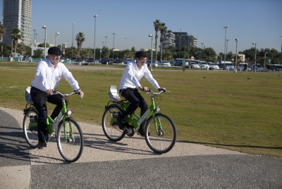 Two men ride Tal-Ofen bicycles in Tel Aviv. Photo by Lior Mizrahi/Flash90