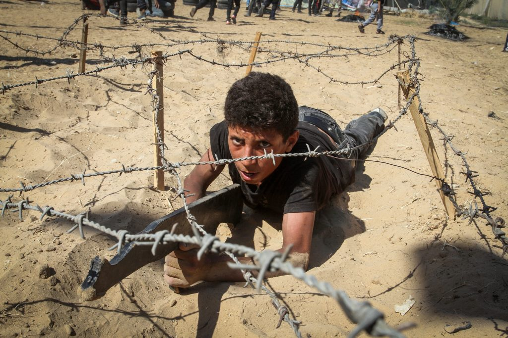 Young Palestinians take part in a military-style exercise at a summer camp organised by the Islamic Jihad movement in Khan Yunis in the southern Gaza. (Abed Rahim Khatib/ Flash90/FILE)