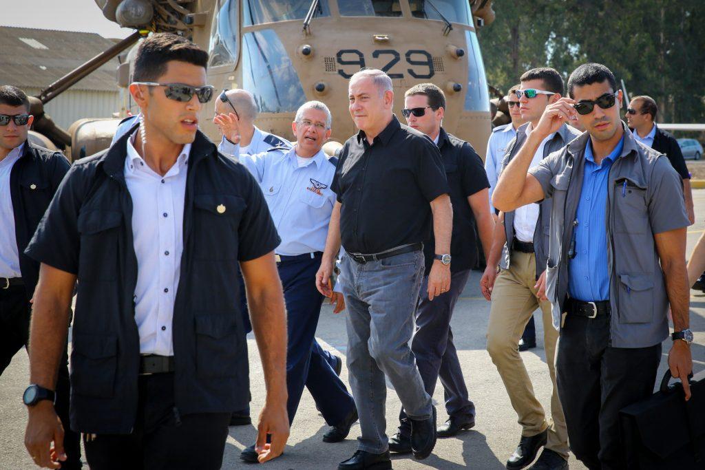 Israel's Prime minister Benjamin Netanyahu walks with Amir Eshel, the Commander in Chief of the Israel Air Force during a visit of Netanyahu at the Tel Nof Airofrce base, on August 17, 2016. Photo by Flash90 *** Local Caption *** çéì äàååéø áñéñ ááñéñ úì ðåó øàù îîùìä áðéîéï ðúðéäå îîùìä øàù àîéø àùì îô÷ã çéì äàååéø