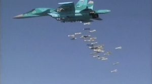 A screen grab released by Russia's Defense Ministry Thursday, shows a Russian Sukhoi Su-34 fighter-bomber, based at Iran's Hamadan air base, dropping bombs onto the Syrian province of Deir ez-Zor. (Ministry of Defense of the Russian Federation/Handout via Reuters)