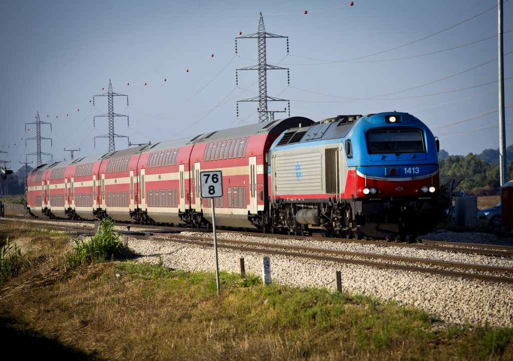 An Israel Railways train seen in the northern Hefer Valley. (Moshe Shai/Flash90/FILE)