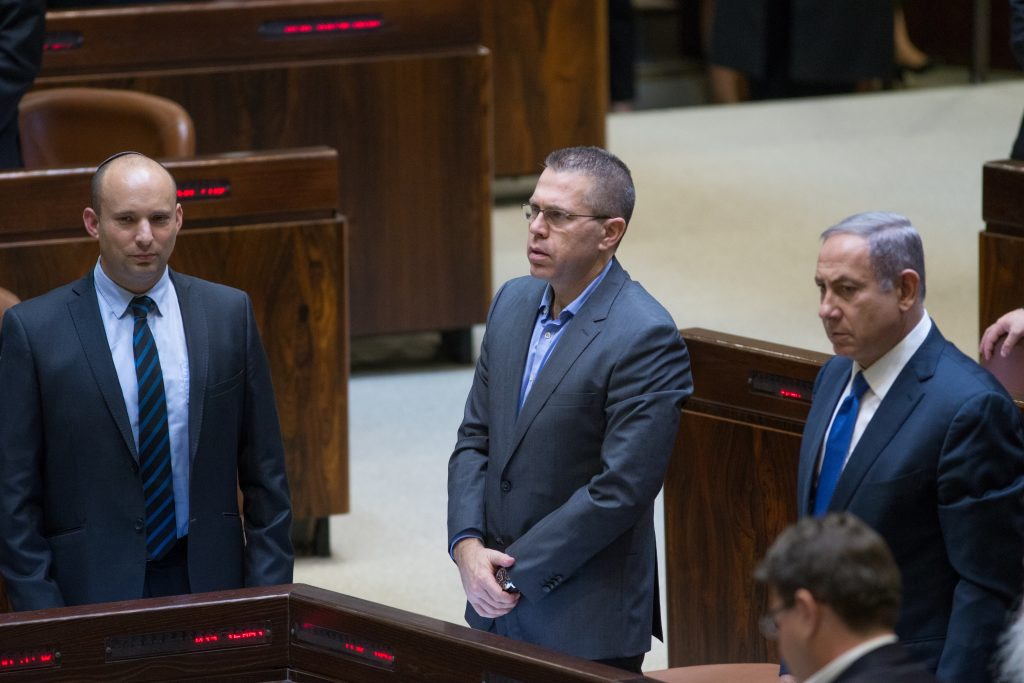 A brief timeout in the battle between Israeli Prime Minister Binyamin Netanyahu (2R) and Education Minister Naftali Bennett (L) in the Knesset on Monday. (Yonatan Sindel/Flash90)