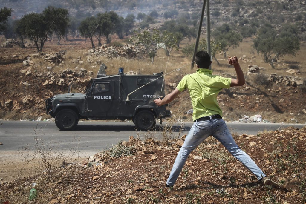 A Palestinian rock thrower in the village of Qusra near Shechem, earlier this month. (Flash90)