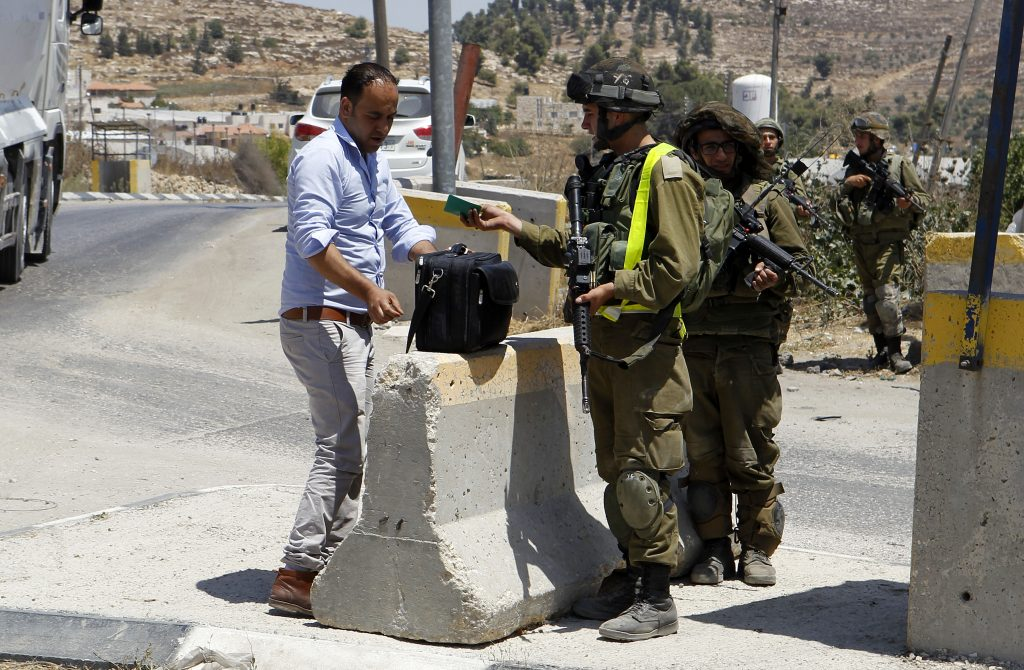 Israeli army soldiers stand guard at a checkpoint. (Wisam Hashlamoun/Flash90)