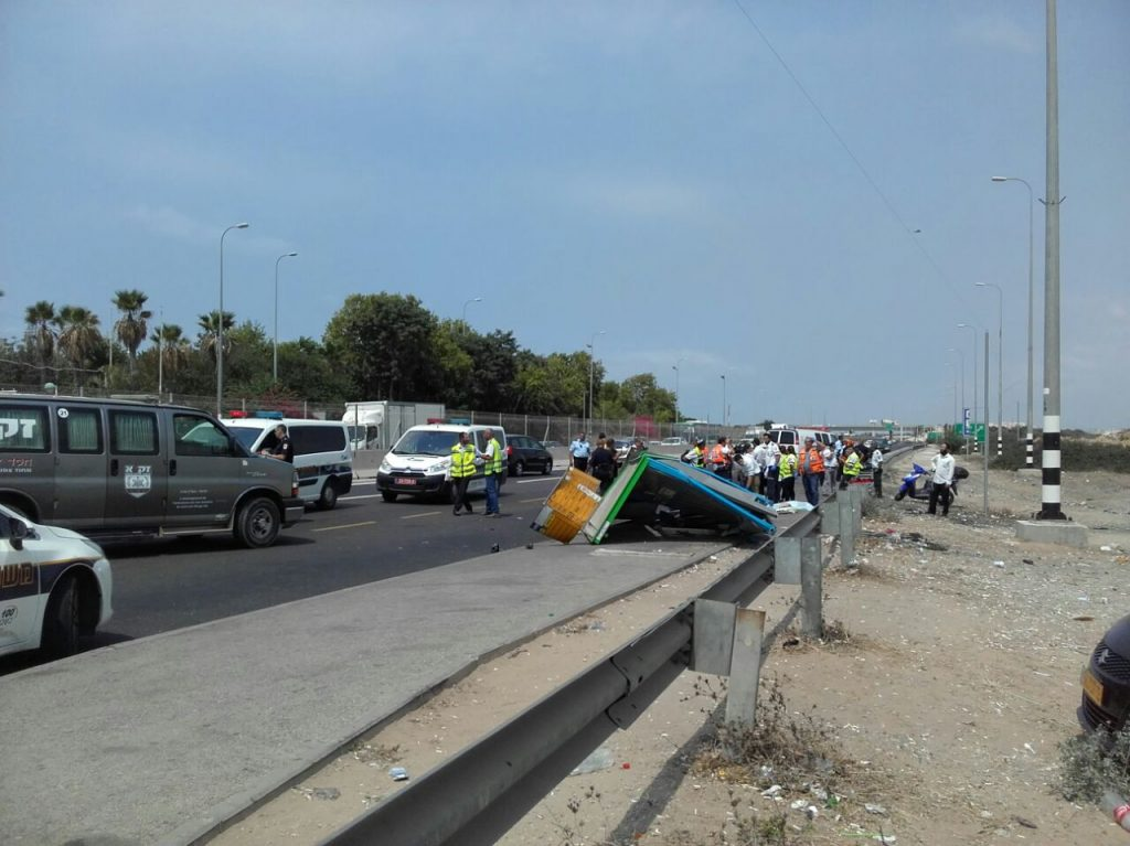 Security and medical personnel at the scene of the fatal crash, Tuesday. (Chofi Barnes)