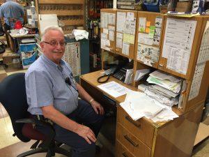 Sam Levi at his desk in Boro Park Lumber. (Yosef Caldwell)
