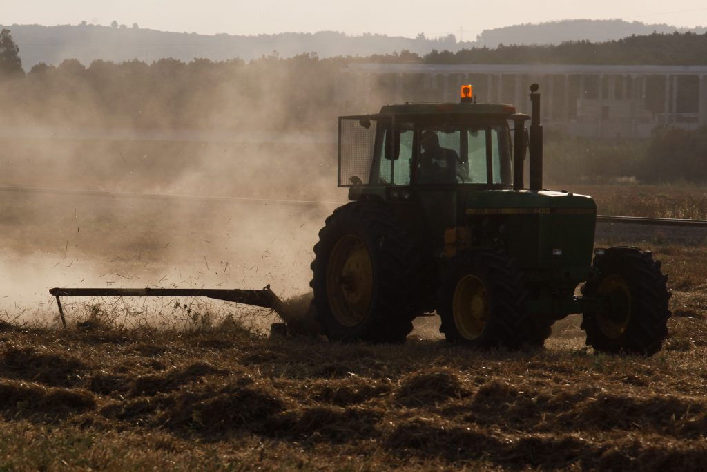 A tractor plowing a field near the city of Beit Shemesh. (Nati Shohat/Flash90)