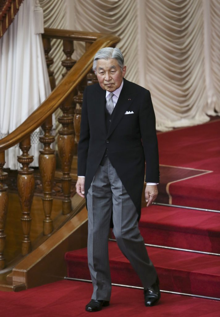 Japan's Emperor Akihito leaves Monday after the extraordinary Diet session was formally opened at the upper house of the parliament in Tokyo. (AP Photo/Koji Sasahara)
