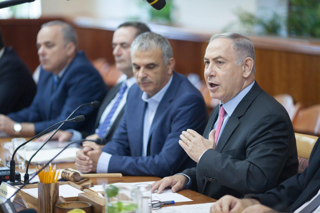 Israeli Prime Minister Binyamin Netanyahu addresses the weekly cabinet meeting on Thursday. (Emil Salman/Pool)