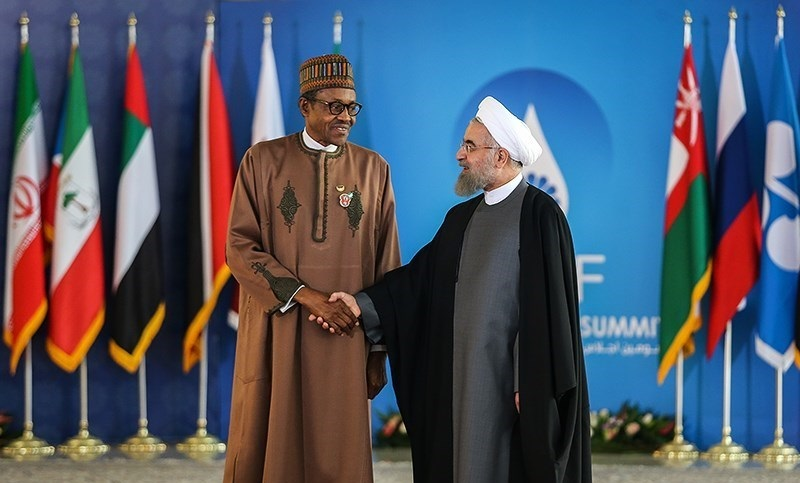 Nigerian President Muhammadu Buhari with Iranian President Hassan Rouhani during the Third GECF (Gas Exporting Countries Forum) summit, in Tehran on November 23, 2015. (Hamed Malekpour)