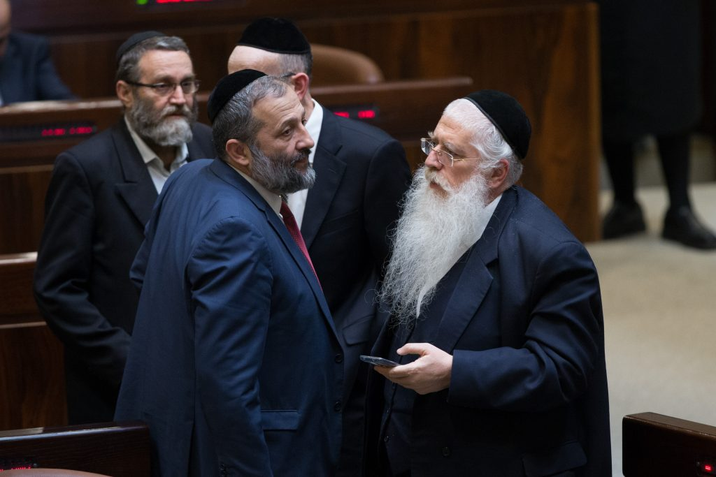 The charedi parties are up in the polls. Interior Minister Rabbi Aryeh Deri, chairman of Shas (Center), with Deputy Education Minister Rabbi Meir Porush (United Torah Judaism) on the right, and Finance Committee chairman Rabbi Moshe Gafni, (UTJ) on left. (Yonatan Sindel/Flash90)