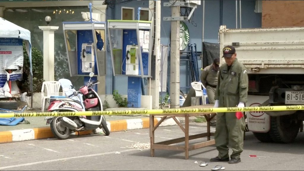Police Explosive Ordnance Disposal (EOD) official inspects the site of a bomb blast in Hua Hin, south of Bangkok, Thailand, in this still image taken from video August 12, 2016. REUTERS/REUTERS TV