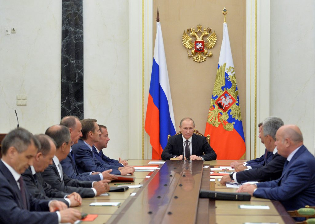 Russian President Vladimir Putin chairs a meeting with members of the Security Council to discuss additional security measures for Crimea after clashes on the contested peninsula, at the Kremlin in Moscow, Russia, August 11, 2016. Sputnik/Kremlin/Alexei Druzhinin/via REUTERS ATTENTION EDITORS - THIS IMAGE WAS PROVIDED BY A THIRD PARTY. EDITORIAL USE ONLY.