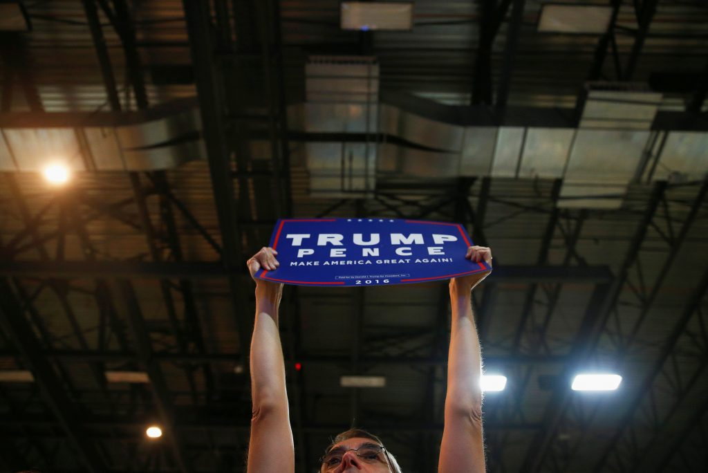 A supporter holds up a sign before Republican U.S. Presidential nominee Donald Trump and his running mate vice presidential candidate Mike Pence attend a campaign event at the Iowa Events Center in Des Moines, Iowa August 5, 2016. REUTERS/Eric Thayer