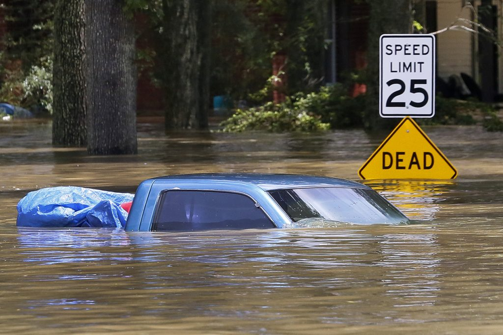 A submerged vehicle is seen in Ascension Parish, Louisiana, U.S., August 15, 2016. REUTERS/Jonathan Bachman