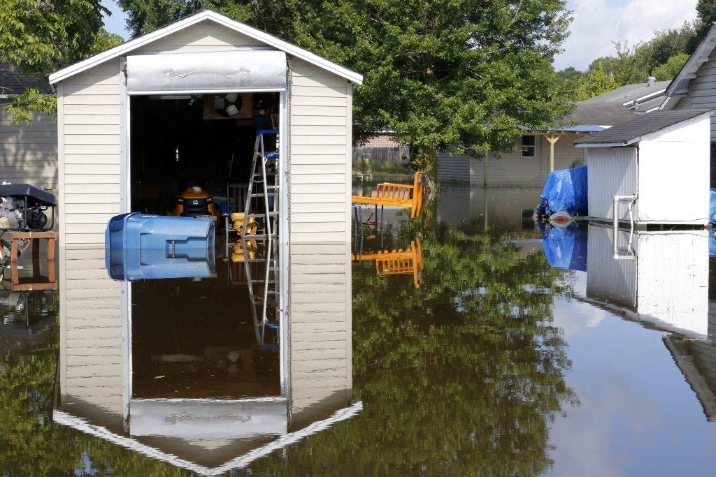 A flooded neighborhood is seen in Sorrento, Louisiana, U.S., August 20, 2016. REUTERS/Jonathan Bachman