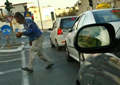 A beggar plies his trade. Photo by Pierre Terdjman / Flash90