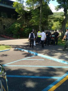 The bachurim, with a Chaveirim volunteer, police officers, and a park official. (News Breakers)