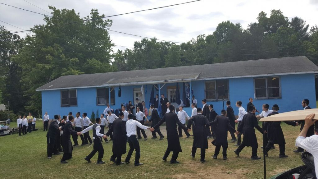 Joyful dancing in Camp Stolin Friday to celebrate the return of the missing bachurim. (News Breakers)