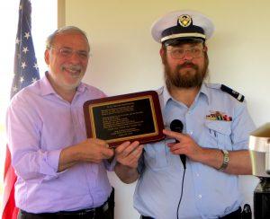 Yaakov Yosef Rosenberg (R) presenting a plaque of appreciation to NYS Assemblyman Dov Hikind. (Rosenberg family)