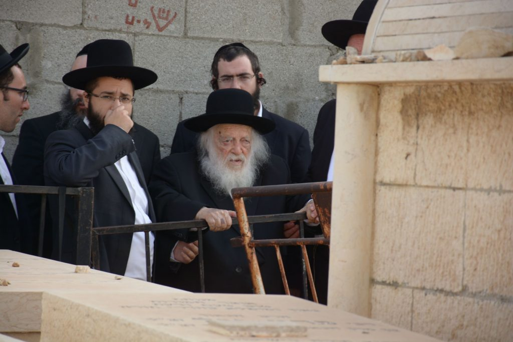 """Hagaon Rabbi Chaim Kanievsky at The Zion of his Father The Steipler Zy""""u Who's Yurtzeit was This Shabbos. (JDN)"""