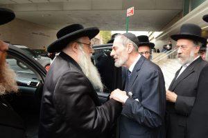 The Rebbe entering Maimonides hospital to visit Rav Binyanim Williger.