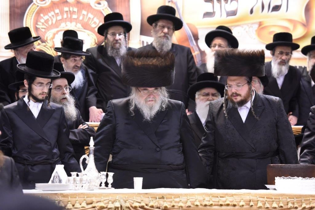 The Belzer Rebbe (C) lead the dancing at the tenaim tisch. (Moshe Goldstein)
