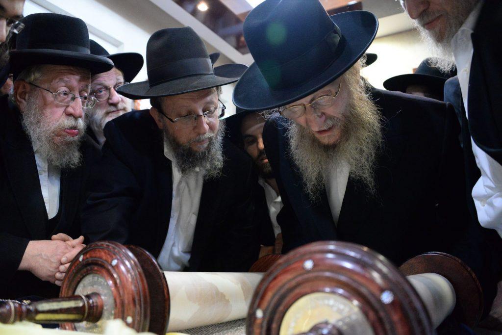 Harav Don Segal writes the final letters of the new sefer Torah. (JDN)