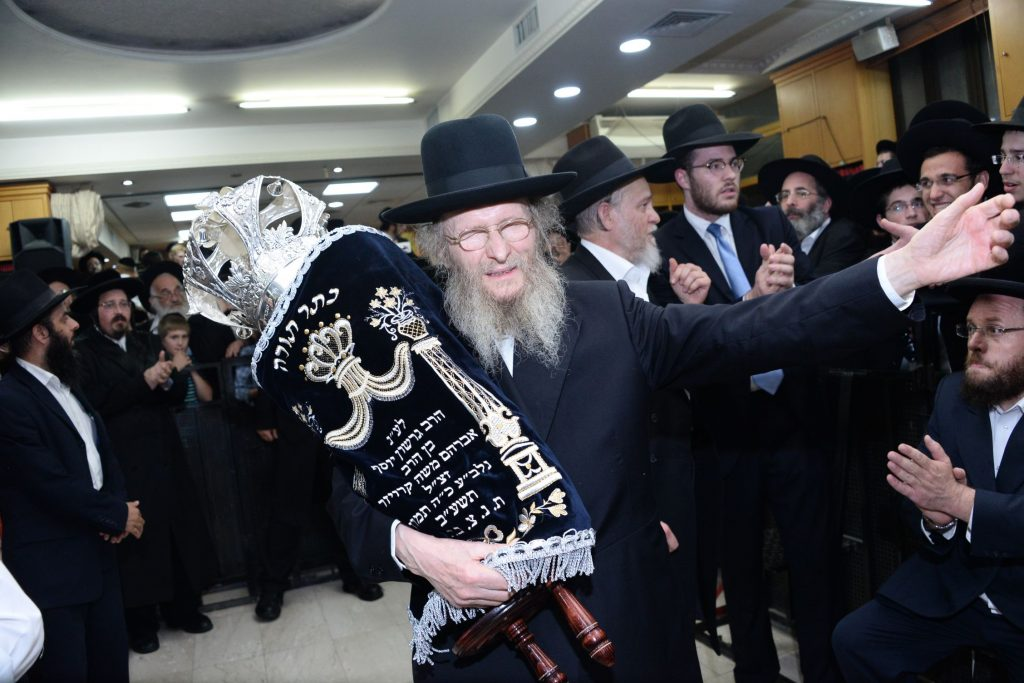 Harav Don Segal dancing with the new sefer Torah. (JDN)