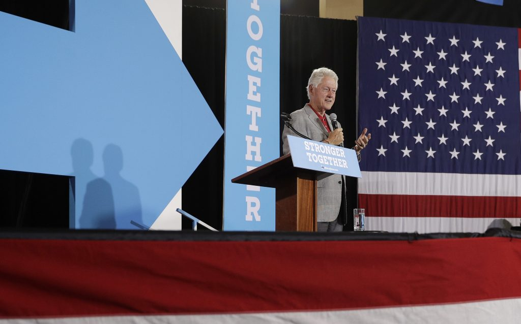 Former President Bill Clinton fills in for his wifer at a while campaigning for his wife at a campaign event in North Las Vegas, Nev., on Wednesday. (AP Photo/John Locher)