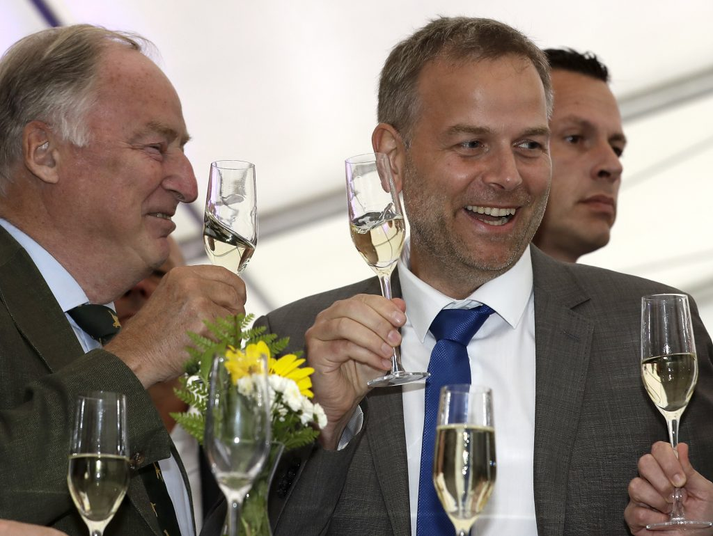 AfD member Alexander Gauland (L) and Leif-Erik Holm, top candidate of the AfD, toast at the gathering of the AfD (Alternative for Germany) party in Schwerin, Germany, on Sunday, after the  state elections in the German federal state of Mecklenburg-Western Pomerania. (AP Photo/Michael Sohn)