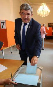Lorenz Caffier, top candidate of Chancellor Angela Merkel's Christian Democrats, casts his vote in Neustrelitz, eastern Germany, for the state elections in Mecklenburg-Western Pomerania, on Sunday. (Bernd Wuestneck/dpa via AP)