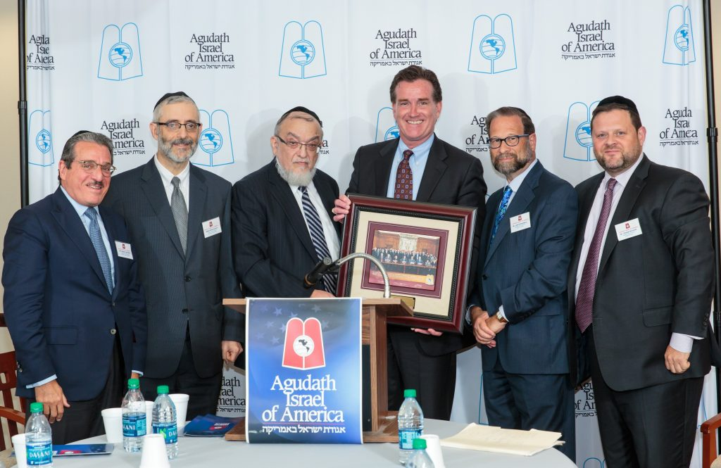 Agudath Israel leaders presenting a plaque of appreciation to Sen. Flanagan. (L-R) Mr. Shlomo werdiger, Rabbi Chaim Dovid Zwiebel, rabbi Shmuel Lefkowitz, Sen. Flanagan, Mr. Leone Goldenberg, Mr. Chaskel Bennett. (Moshe Gershbaum)