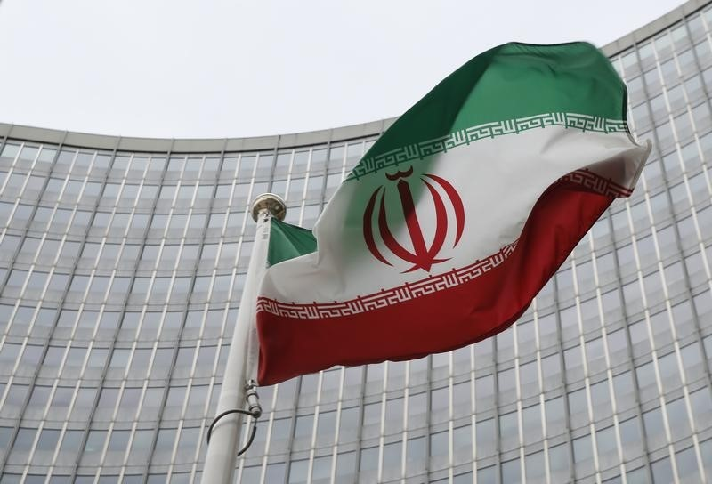 An Iranian flag flutters in front of the International Atomic Energy Agency (IAEA) headquarters in Vienna, Austria. (Leonhard Foeger/Reuters)
