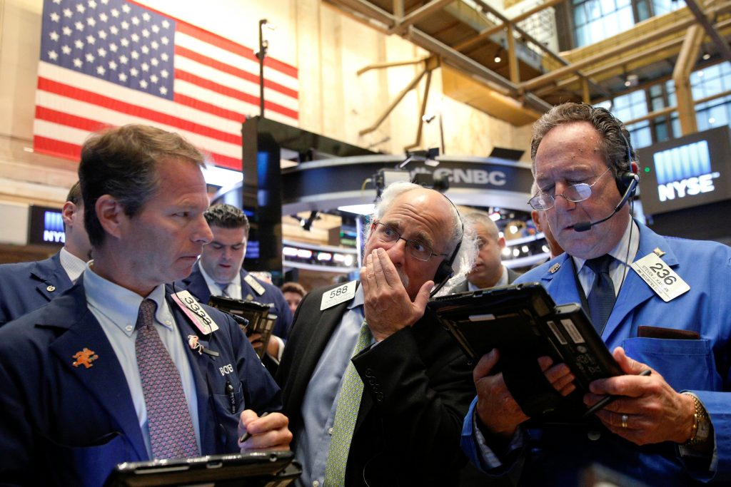 Traders work on the floor of the New York Stock Exchange on Tuesday. (Reuters/Brendan McDermid)