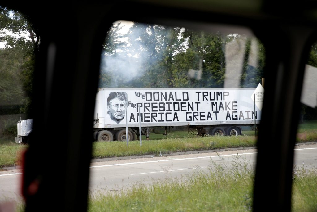 A truck advertising Republican presidential nominee Donald Trump is seen from a press bus as it passes Trump's motorcade during a campaign stop in Flint, Michigan, on Wednesday. (Reuters/Mike Segar)