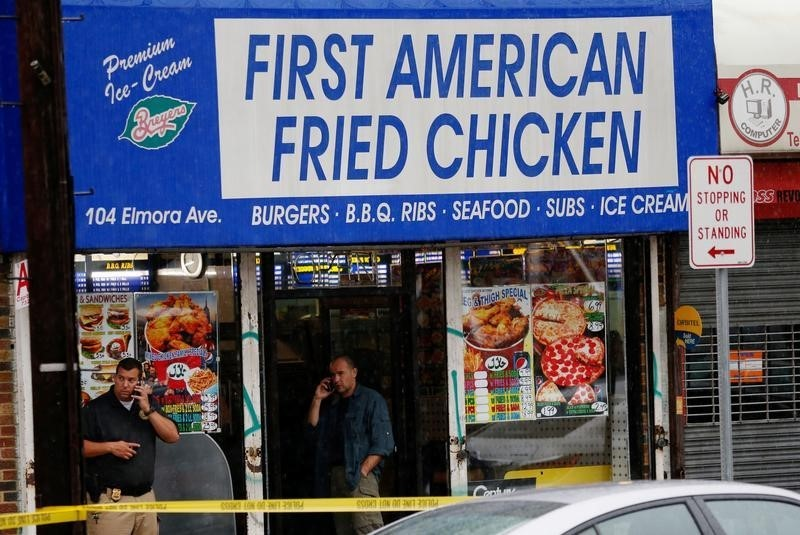 Law-enforcement officers search at the Rahami family's fried-chicken store in, in Elizabeth, N.J. on Monday. (Reuters/Eduardo Munoz)