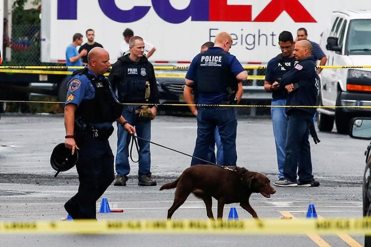 Law enforcement officers mark evidence near the site where Ahmad Khan Rahami, sought in connection with a bombing in New York, was taken into custody in Linden, New Jersey. (Eduardo Munoz/Reuters)