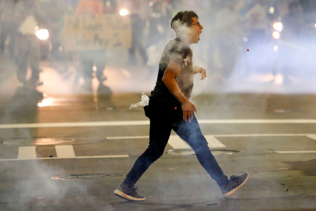 A man is hit with pepper spray paint balls in uptown Charlotte, NC during a protest of the police shooting of Keith Scott, in Charlotte, North Carolina. (Jason Miczek/Reuters)