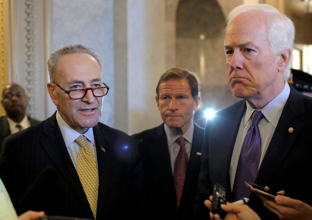 (L-R) Senators Chuck Schumer (D-NY) Richard Blumenthal (D-CT), and John Cornyn (R-TX), speak to the media on Capitol Hill Wednesday after the Senate voted to override President Barack Obama's veto of a bill that would allow lawsuits against Saudi Arabia's government over the 9/11 attacks. (Reuters/Joshua Roberts)