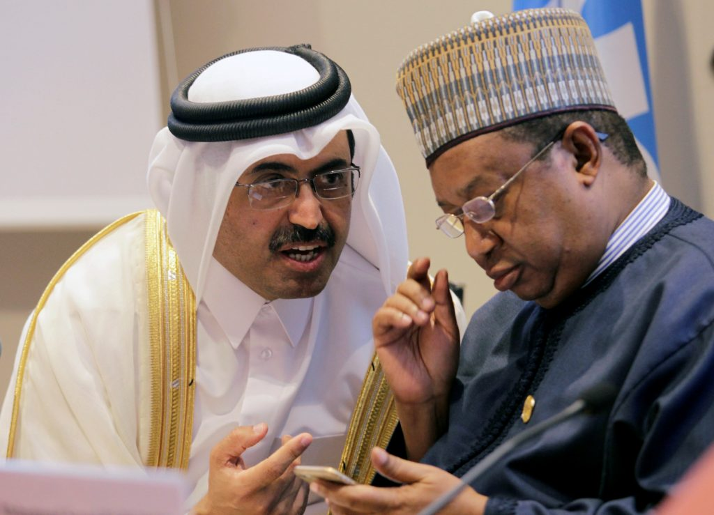 Organization of Petroleum Exporting Countries (OPEC) President, Qatar's Minister of Energy Mohammed bin Saleh al-Sada speaks with Secretary General of OPEC Mohammed Sanusi Barkindo (R), during a news conference after an informal meeting between members of the organization in Algiers, Algeria September 28. (Ramzi Boudina/Reuters)