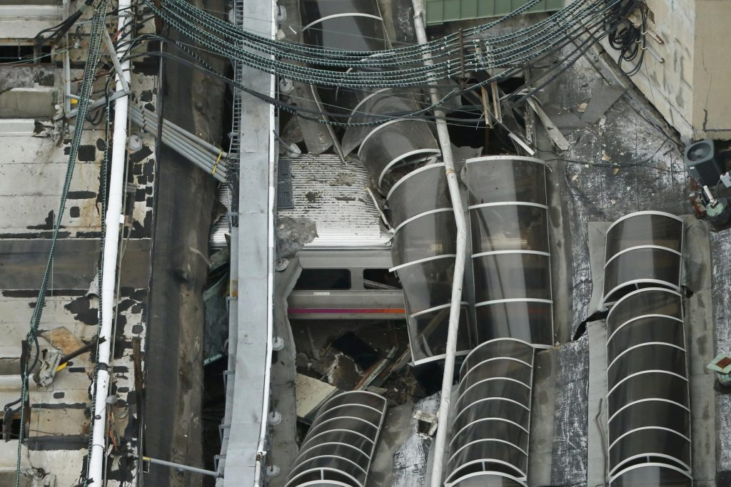 A derailed New Jersey Transit train is seen under a collapsed roof after it derailed and crashed into the station in Hoboken, N.J., on Thursday. (Reuters/Carlo Allegri)