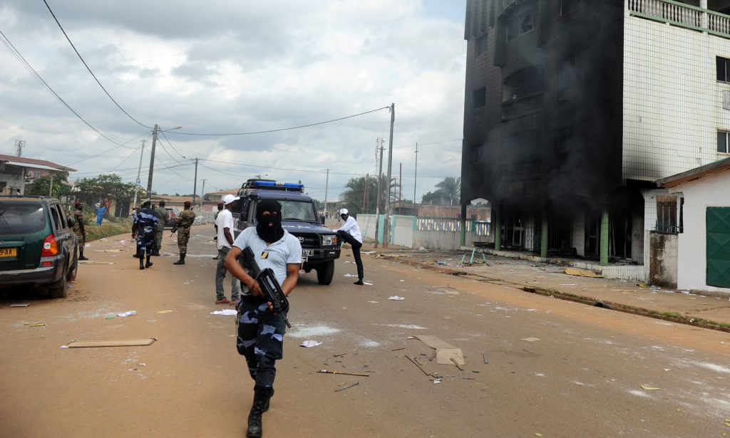 Gabonese Police stand guard on a barricade following an election protest in Libreville, Gabon, on Sept. 1. (AP Photo/Joel Bouopda, File)